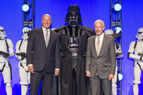 Disney Consumer Products President, Bob Chapek, left, and Lucasfilm Executive Vice President Howard Roffman pose with Darth Vader and 20 Stormtroopers as they take over the stage during a private Disney event at the Licensing Expo, Monday June 17, 2013 at the Mandalay Bay Convention Center in Las Vegas. This surprise grand finale, presented to more than 1,500 licensees, demonstrates a new era of merchandising potential for Disney Consumer Products' robust franchise portfolio, which now includes the Star Wars franchise. (Photo by Eric Jamison/Invision for Disney Consumer Products/AP Images)