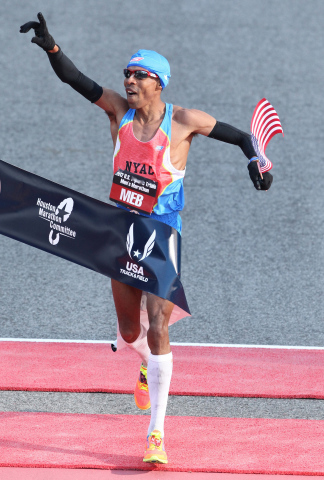 Meb celebrates his win at the finish line of the 2012 U.S. Olympic Marathon Trials in Houston. (Phot ...