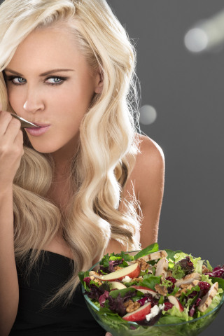 Carl's Jr. launches the Cranberry Apple Walnut Grilled Chicken Salad today. Actress Jenny McCarthy stars in the sexy new commercial for the salad. (Photo: Business Wire)