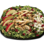 The new Cranberry Apple Walnut Grilled Chicken Salad, available at Carl's Jr. today, features a variety of flavors and premium ingredients. (Photo: Business Wire)