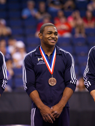 Team Hilton HHonors Member John Orozco is shown on the medals podium at the U.S. nationals after winning the 2012 U.S. all-around title. (Photo: USA Gymnastics)