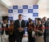 Mr. Madhusudan Thakur, Regional Vice-President, South Asia, Regus, flanked by youths wearing traditional Nepalese dress, inaugurating the Regus Business Centre at Kathmandu, Nepal.