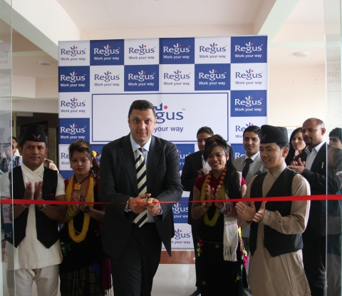 Mr. Madhusudan Thakur, Regional Vice-President, South Asia, Regus, flanked by youths wearing traditi ...