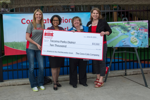 Coca-Cola Ambassador Anna Arodzero presents a $10,000 Grant to help fund a play and spray ground at ...