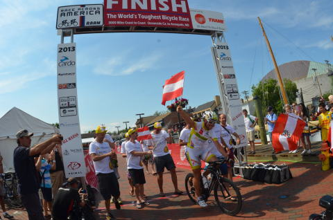 Austrian cyclist, Christoph Strasser crosses the finish line of the 3,000 mile transcontinental Race Across America Powered by Trane in a record-setting seven days, 22 hours and 52 minutes in Annapolis, Md.
