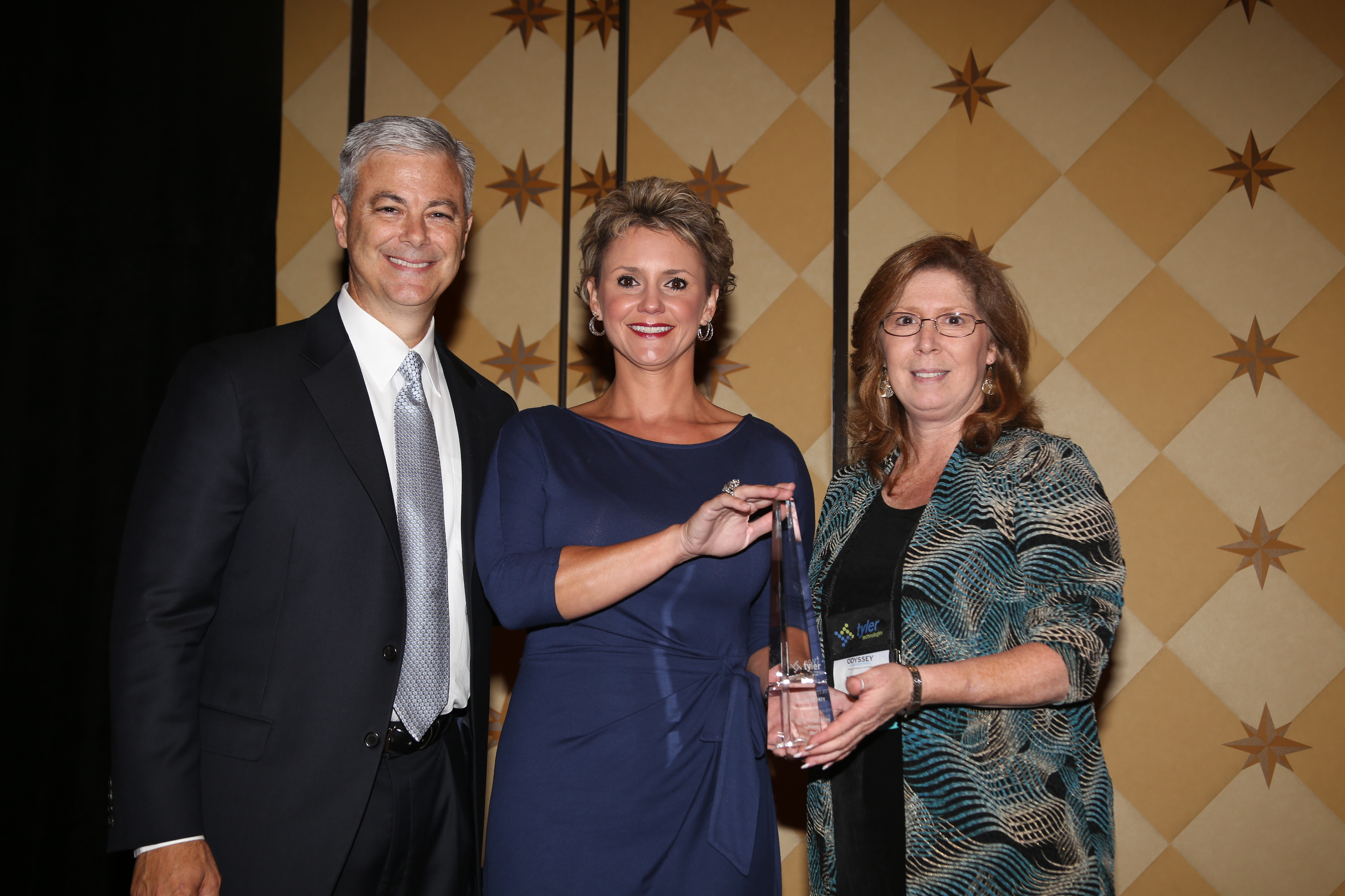 Bruce Graham, president of Tyler's Courts & Justice Division, presents a Tyler Public Sector Excellence Award to Denton County. (Photo: Business Wire)