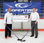 Cooper Tire North America Tire Operations President Chris Ostrander (right) presents Hockey Education Reaching Out Society (HEROS) Executive Director Norm Flynn (left) with a $25,000 donation. (Photo: Business Wire)