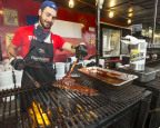 Texas Rangers ribber, Derek Buchanan, fires up the grill at Toronto Ribfest at Centennial Park, June 28 to July 1. (Photo: Business Wire)