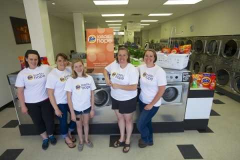 Tide Loads of Hope team assisting people affected by recent Alberta floods. (Photo: Business Wire)