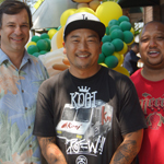 (from left to right) Stuart McAllister, director of field sales for Dole Packaged Foods, Chef Roy Choi, co-founder of Kogi and Mark Wilson, executive director of the CRCD, gather for the opening of 3 Worlds Cafe in South Central Los Angeles on Saturday, July 6, 2013. 3 Worlds Cafe is a collaboration between the three organizations and Jefferson High School in an effort to educate students about healthy food options while providing essential job skills training. 3 Worlds Cafe