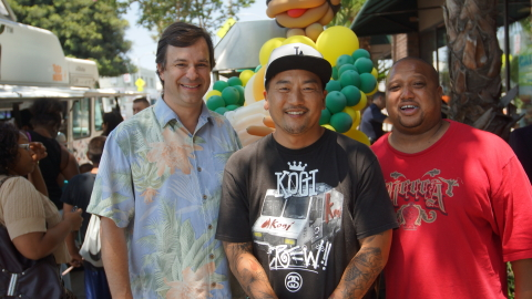 (from left to right) Stuart McAllister, director of field sales for Dole Packaged Foods, Chef Roy Choi, co-founder of Kogi and Mark Wilson, executive director of the CRCD, gather for the opening of 3 Worlds Cafe in South Central Los Angeles on Saturday, July 6, 2013. 3 Worlds Cafe is a collaboration between the three organizations and Jefferson High School in an effort to educate students about healthy food options while providing essential job skills training. 3 Worlds Cafe will offer the South Central community year round fresh fruits in the form of fruit smoothies, frozen treats and more, while also serving as a community hub for art, music and literary exhibitions. (Photo: Business Wire)