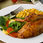 Boston Market is featuring several picnic-themed promotions throughout the summer. Menu items including rotisserie chicken (pictured) and barbeque ribs are ideal for summer picnicking. (Photo: Business Wire)