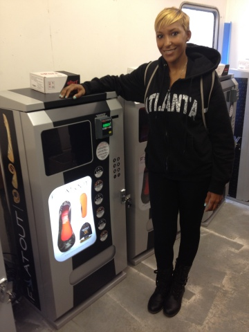 Flat Out of Heels CEO, Dawn Dixon, with ESON Design rollable shoe kiosk, cashless by USAT. (Photo: F ...