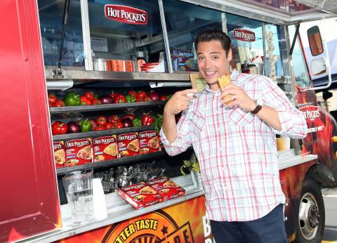 """In this photo released by Nestlé Prepared Foods/Hot Pockets brand sandwiches on July 16, 2013 - Food Network's """"Sandwich King"""" Jeff Mauro is seen on location with the new Hot Pockets brand sandwiches in Los Angeles. (Photo by Casey Rodgers/Invision for Nestlé Prepared Foods/Hot Pockets/AP Images)"""