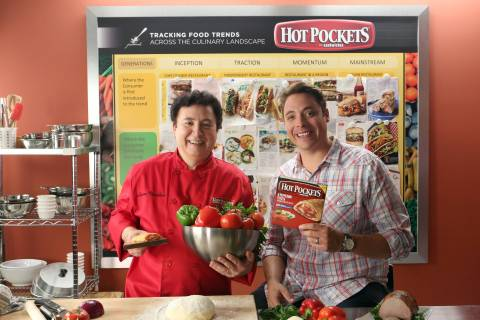 """In this photo released by Nestlé Prepared Foods/Hot Pockets brand sandwiches on July 16, 2013 - Food Network's """"Sandwich King"""" Jeff Mauro and Chef Lucien Vendôme, Director of Nestlé Culinary Innovations, reveal the new Hot Pockets brand sandwiches at the Nestlé kitchen in Chatsworth, Calif. (Photo by Casey Rodgers/Invision for Nestlé Prepared Foods/Hot Pockets/AP Images)"""