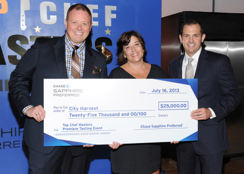 Jeff Bedard, Marketing Director for Chase Sapphire Preferred, right, presents a $25,000 donation to ...