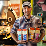 Just Love Coffee Roasters' Founder Rob Webb with New Love Ones Packaging (Photo: Business Wire)