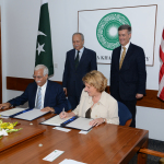Overseas Private Investment Corporation President and CEO Elizabeth L. Littlefield and President and CEO Firoz Rasul of the Aga Khan University, on behalf of the Aga Khan Hospital and Medical College Foundation, sign a Loan Agreement to provide financing for expansion of the Aga Khan University Hospital. U.S. Ambassador to Pakistan Richard Olsen and Chairman of the Board of Trustees of the Aga Khan University Ambassador Saidullah Khan Dehlavi officiated at the ceremony. (Photo: Aga Khan University)