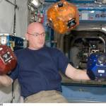 A NASA astronaut with three SPHERES floating freely in the International Space Station. (Photo: Business Wire)