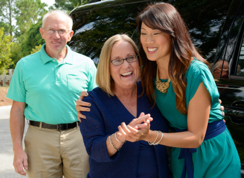 HGTV host Chi-Lan Lieu (right) welcomes HGTV Smart Home 2013 Giveaway winner Peggy Walker and husband Paul to their new home in Jacksonville Beach, Fla. Walker's winning entry was selected at random from more than 40 million received during the inaugural HGTV Smart Home Giveaway. (Photo: Business Wire)