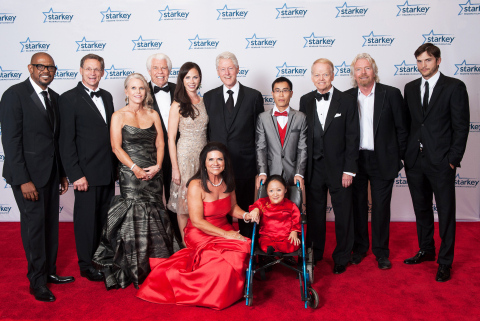 Honorees and presenters from the 13th annual So the World May Hear Gala pose with Bill and Tani Aust ...