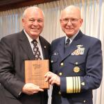 Undated photo of US Coast Guard Commandant Robert J. Papp, Jr. presenting AdvanFort President William H. Watson a plaque for service to the Amver program. (Photo: Business Wire)