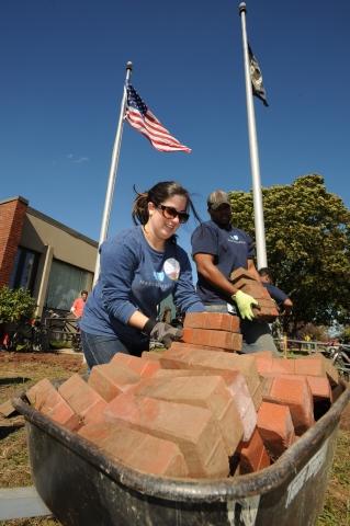 Blue Cross Blue Shield of Massachusetts's associate volunteers, known as BlueCrew, lending a helping ...