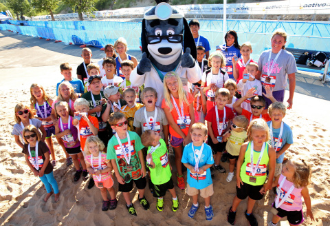 Young athletes are pictured with UnitedHealthcare mascot Dr. Health E. Hound at the UnitedHealthcare ...