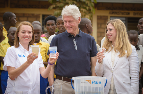 President Bill Clinton and Chelsea Clinton join Procter & Gamble's Allison Tummon Kamphuis in purify ...
