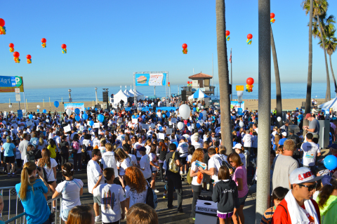 Thousands of community members participate in the annual SKECHERS Pier to Pier Friendship Walk (Phot ...