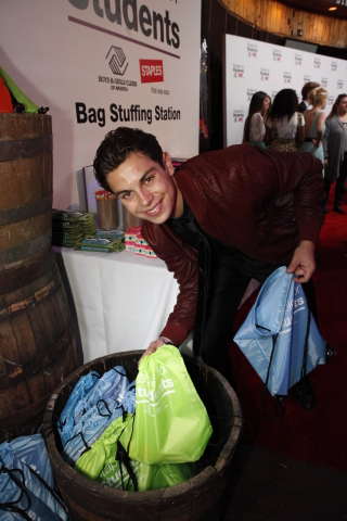 Celebrity Jake T. Austin stuffed bags full of school supplies for kids from Boys & Girls Clubs of Am ...