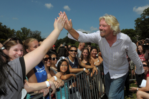 Sir Richard Branson greeting past Virgin Mobile FreeFest attendees who earned tickets by volunteerin ...