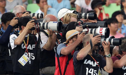 Photographers shoot the August 2011 IAAF World Championships in Daegu, South Korea. (Photo: Michael  ...