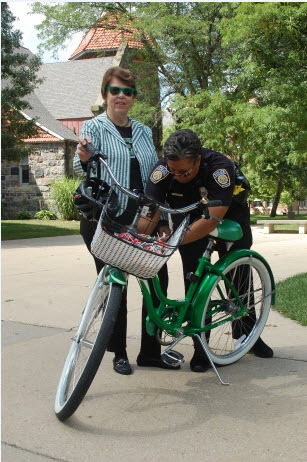 BikeGuard officially launched yesterday when the President of Eastern Michigan University, Susan Martin, registered her own bicycle. (Photo: The Eastern Echo)