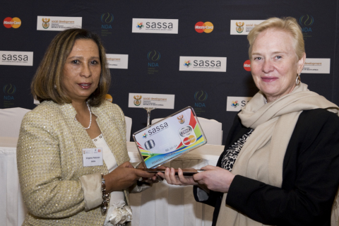 Ann Cairns, President of International Markets, MasterCard (right) presents Virginia Petersen, CEO o ...