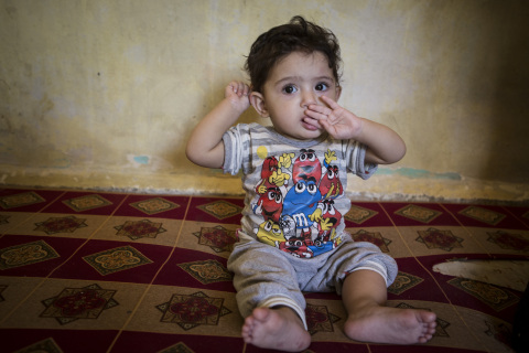 Rasha*, 1, at her home in an unfinished building in Lebanon, near the Syrian border. Jonathan Hyams/ ...