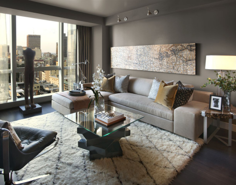 The living room features a cozy color palette, floor-to-ceiling windows and unobstructed views over ...