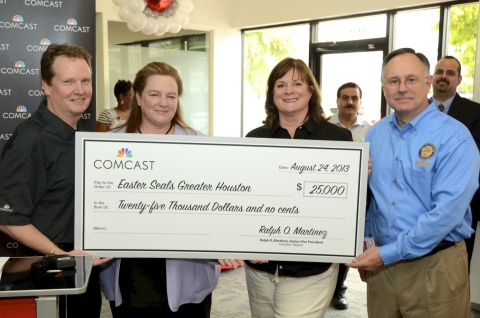 Pictured are, from left to right, Ray Purser, vice president of government and public relations for Comcast's Houston region; Elise Hough, CEO Easter Seals Greater Houston; Carolyne Hannan, vice president of marketing for Comcast's Houston region; and Mike Laster, Houston City Council Member. (Photo: Business Wire)