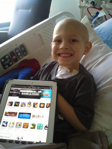 To support and empower young cancer patients, global health service company Cigna has teamed up with the Childhood Leukemia Foundation to provide free iPads preloaded with HopeLab's cancer-fighting game app Re-Mission 2: Nanobot's Revenge to patients through CLF's Keeping Kids Connected program. (Photo: Cigna)