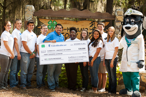 "Tallahassee - Florida 4-H State Council Officers along with UnitedHealthcare executives kick-start the full day of ""Eat 4-Health"" fitness activities with a $30,000 grant provided by UnitedHealthcare to the University of Florida Extension Service, which provides 4-H programs to all counties in the state. The ""Eat4-Health"" partnership will train ""Teen Health Ambassadors"" about healthy eating and the importance of exercise as part of a program aimed at reducing obesity rates among young people and families in Florida. Pictured left to right: Kaitlyn Pace from Santa Rosa, Jared Smith from Hastins, Jake Menendez from Okeechobee, Andrew Horvath from Live Oak, UnitedHealthcare Vice President of Sales and Marketing Abe Gonzalez, Cassandra Weston, 4-H Youth Development Extension Agenda from Miami, Emily Freeman from Miami, Gabby Valentin from Marion, Scott Read from Jacksonville, Sarah Baltzell from Madison and UnitedHealthcare's mascot, Dr. Health E. Hound. (Photo: Dawn McKinstry)"