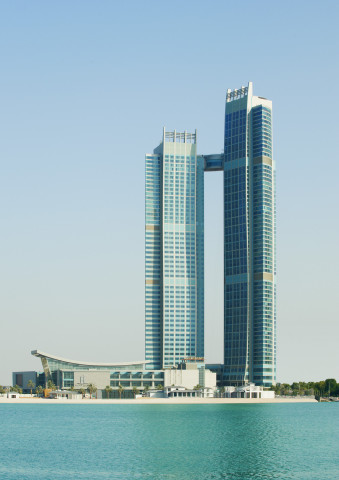 Exterior of The St. Regis Abu Dhabi with suspended 'Abu Dhabi Suite' between two towers (Photo: Busi ...