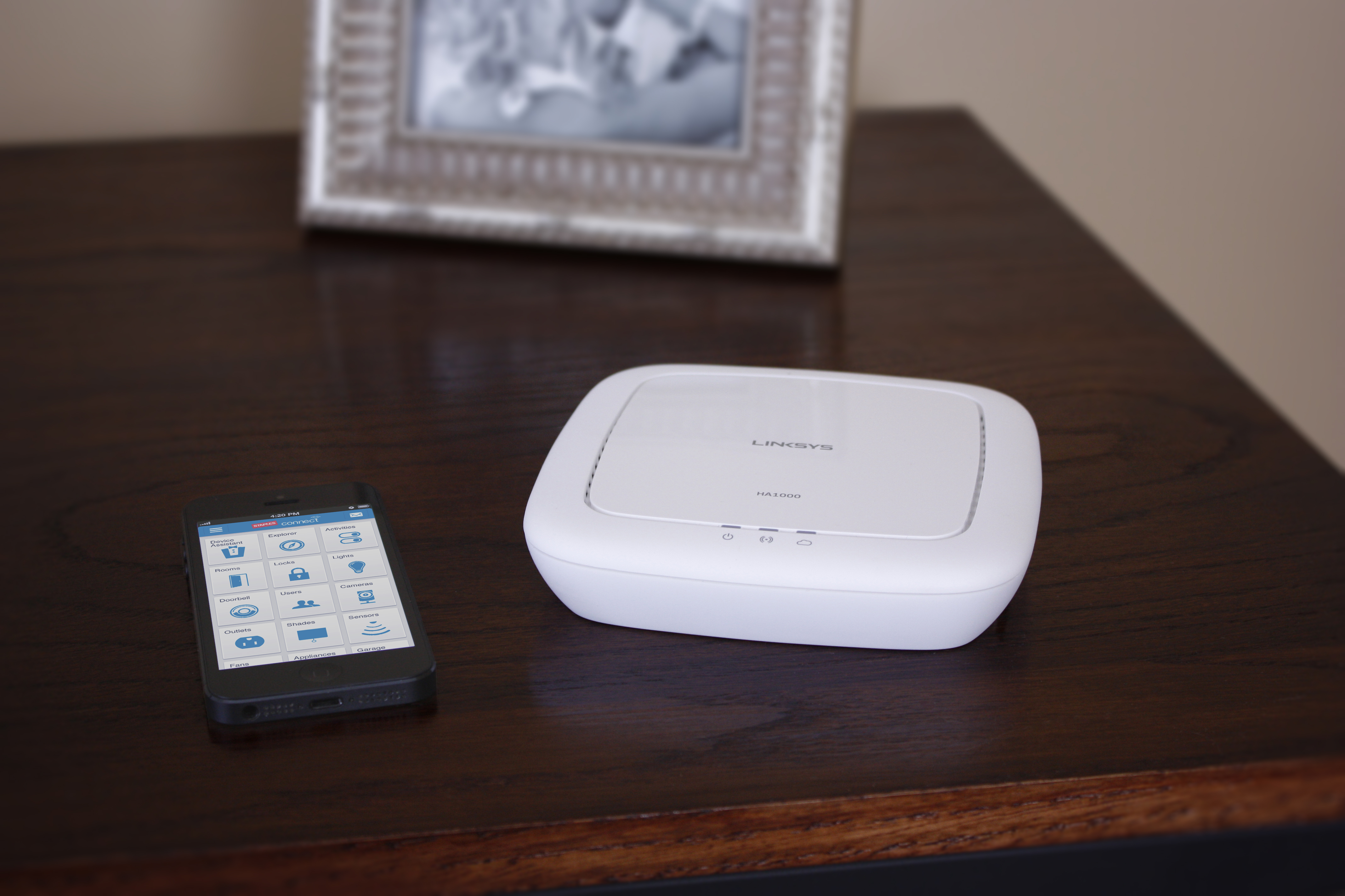 "Staples Connect consists of a multi-platform app and universal ""Hub"" that allow a multitude of devices to talk to each other. The Staples Connect Hub, powered by Linksys, will be available online and in a limited number of Staples stores for $99 this November. (Photo: Business Wire)"