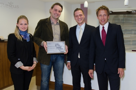 Boris Konau our 1.5 Millionth customer with Christian Schmidt and his local centre team, Georg Rudtke and Mona Olrogge (Photo: Business Wire)