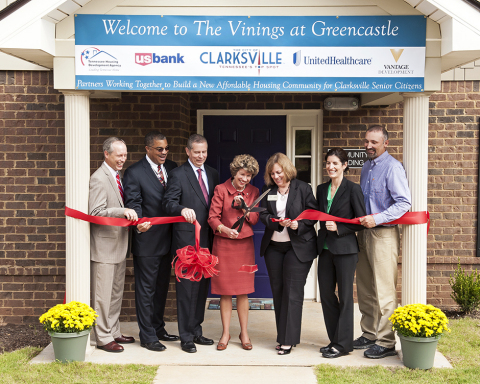 Clarksville Mayor Kim McMillan (center) officiates the ribbon-cutting for The Vinings at Greencastle with State Rep. Joe Pitts and project partners for the new $9.3 million affordable housing community in Clarksville for senior citizens. L to R: Steve Kemmer, Clarksville District Manager, U.S. Bank; Keith Lampkin, Director of the Clarksville Office of Housing and Community Development; Rep. Pitts; Mayor McMillan; Lorrie Shearon, Chief Strategy Officer, Tennessee Housing Development Agency; Dr. Melinda Henderson, Executive Director, Long Term Care & Medicare, UnitedHealthcare; and Lowell Barron II, president, The Vantage Group (Photo: Robbie Quinn).