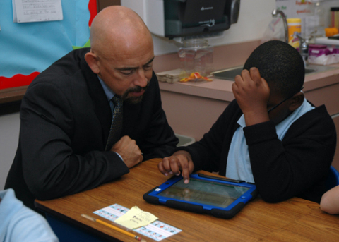 Lt. Governor Garcia admires a UPrep student doing math on an iPad donated by TeleTech. (Photo: Business Wire)