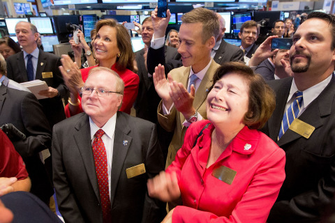 RE/MAX CEO Margaret Kelly in the center of the trading crowd as RE/MAX stock opens for trading on the NYSE. Source: NYSE Euronext photo