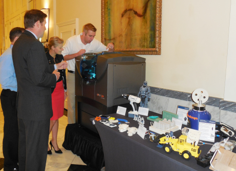Attendees view a demonstration of Stratasys 3D printers at NAM board meeting in Washington D.C. (Pho ...