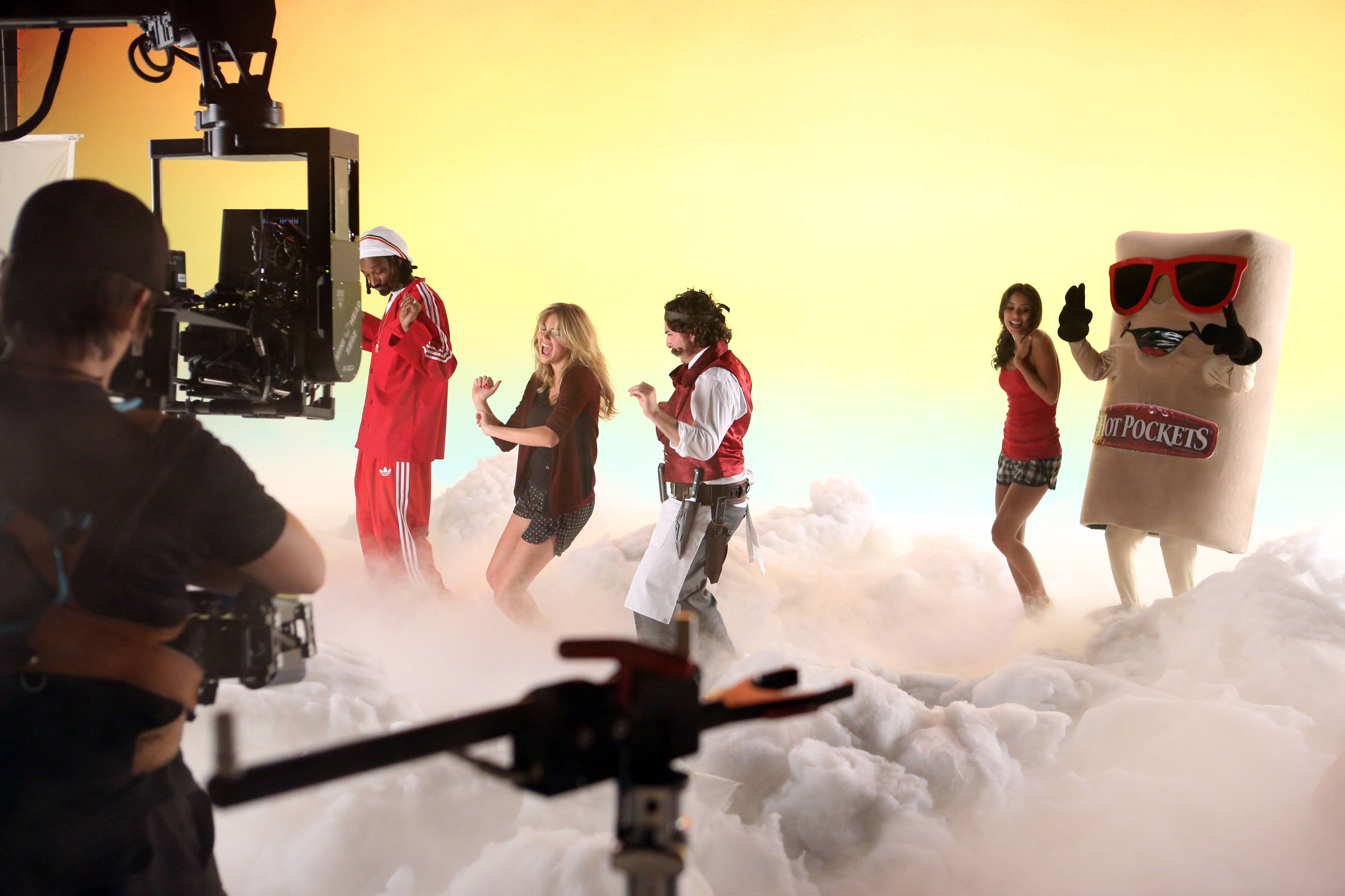 """In this image released by HOT POCKETS® brand sandwiches on Tuesday, Oct. 8, 2013 - Snoop Dogg, Kate Upton and Oliver Cooper are seen on the set of the """"You Got What I Eat"""" music video in Los Angeles; visit hotpockets.com/HotterPockets. (Photo: Business Wire)"""