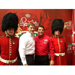 Papa John's founder, chairman, and CEO, John Schnatter, second from right, and Tony Thompson, Papa John's president and COO, celebrate the company reaching the 1,000 international restaurant milestone during a celebration in London. (Photo: Business Wire)