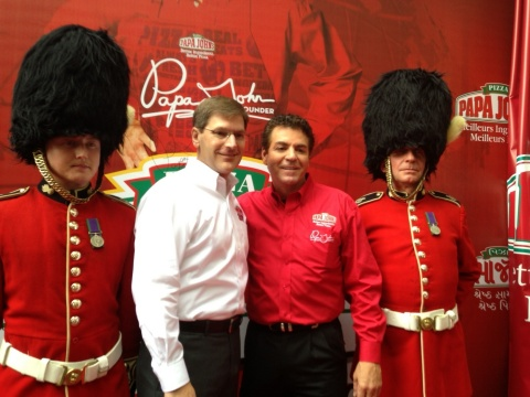Papa John's founder, chairman, and CEO, John Schnatter, second from right, and Tony Thompson, Papa J ...